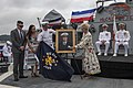 Cindy McCain is presented with a painting of her husband during the 25th anniversary of the ship's commissioning. (48179986116).jpg