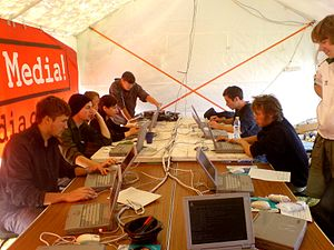 Media transparency - The inside of the media tent and the climate camp in Heathow. 10 workstations, with live satellite up-link and powered from renewables.