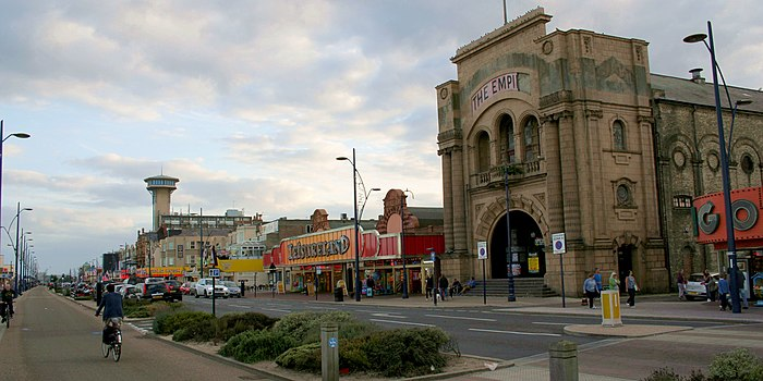 Marine Parade in August 2013, with the derelict Empire Building in the foreground and the Great Yarmouth Tower in the background Cmglee Great Yarmouth Empire Atlantis.jpg