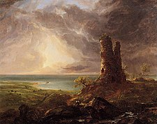 An oil painting showing a ruined stone tower on high ground in the foreground. In the rear is a coast, the sun shines through dark clouds in the sky above.