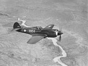 Curtiss P-40, ¾-front view, in flight (00910460 023)