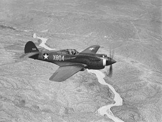 Curtiss P-40 Warhawk - A three-quarter view of a P-40B, X-804 (s/n 39-184) in flight. This aircraft served with an advanced training unit at Luke Field, Arizona.