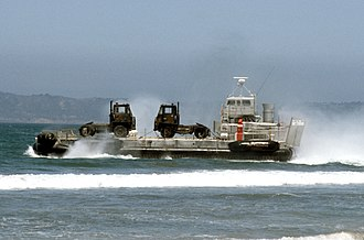 Lighter (barge) - A US Army LACV-30 (Lighter Air Cushion Vehicle - 30 Ton) hovercraft transporting ground-support military equipment to the shore in 1986.
