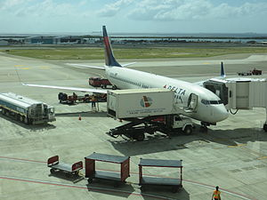 Queen Beatrix International Airport - A Delta 737-800 bound for Atlanta parked at gate 4