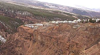 Gilman, Colorado - The town site of Gilman, perched on a cliff above the Eagle River, as viewed from U.S. Highway 24 near Battle Mountain Summit.