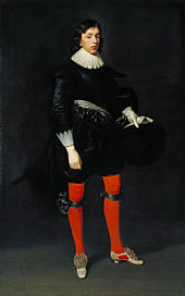 Painting of young man wearing 17th-century dress consisting of bright red hose and a black doublet, holding a black hat and white gloves in his left hand