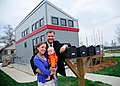 Daniel Oerther poses with Sarah Oerther in front of their home the 2007 solar house in Rolla Missouri.jpg