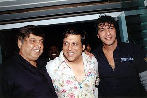 Govinda (actor) - Left to right, David Dhawan, Govinda and Chunky Pandey at a birthday party for Bobby Deol