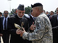 Defense.gov News Photo 100514-F-6655M-019 - Afghan President Hamid Karzai receives a screaming eagle plaque from the Commander of the 101st Airborne Division John Campbell during a visit with.jpg