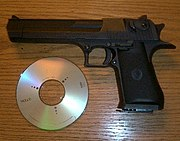 An early Desert Eagle chambered in .357 Magnum with a compact disc for scale