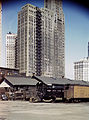 Diesel switch engineer moving freight cars at the South Water street freight terminal of the Illinois Central RR, Chicago, Ill.jpg