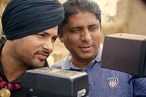 Amrinder Gill - Amrinder Gill (on the left) with Director Simerjit Singh