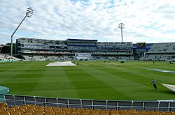 Interior view of the Edgbaston cricket stadium with a small number of people in the stands