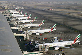 Boeing 777X - A row of Boeing 777-300s and -300ERs at Dubai International Airport of its largest operator, Emirates