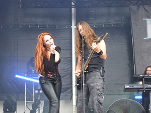 Epica (band) - Lead vocalist Simone Simons and Grunt vocalist and guitarist Mark Jansen during The Divine Conspiracy World Tour.