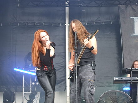 Lead vocalist Simone Simons and Grunt vocalist and guitarist Mark Jansen during The Divine Conspiracy World Tour. Epica Hellfest 2007 22.jpg