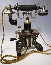 Colour photograph of a late nineteenth-century telephone.