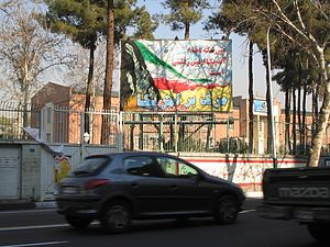 "Embassy of the United States, Tehran - Chancery Building seen from Taleghani Avenue in 2005. Banner reads at bottom, ""Death to America."""