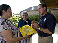 FEMA - 37481 - A resident speaks with a FEMA representative at Town Hall Meeting.jpg