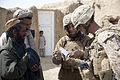 Faria Jalala, a linguist for the U.S. Marine Corps Female Engagement Team 11-2, Task Force Leatherneck, explains how to care for a wound at the district center in Delaram, Nimroz province, Afghanistan March 14 120314-M-BE386-125.jpg