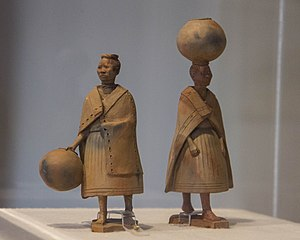 Figurines of women carrying pottery vessels
