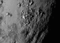 First Ever High Resolution View of Pluto's Surface (19104541793).png