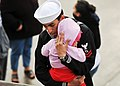 Flickr - Official U.S. Navy Imagery - Sailor embraces his daughter before deploying aboard USS Cleveland..jpg