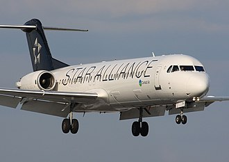 Contact Air - A Contact Air Fokker 100 in Star Alliance colors lands at Prague Ruzyně Airport in 2010.