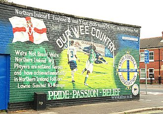 Sunday football in Northern Ireland - A mural in Belfast celebrating a win over England. Sport plays a significant role in national identity in Northern Ireland.
