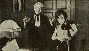 Forget Me Not (1922 film) - Scene from the film with Bessie Love and Otto Lederer