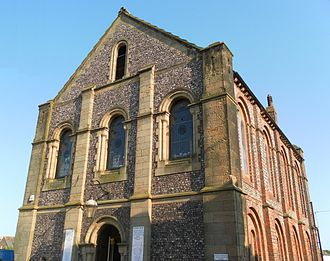 Trinity Congregational Church, Arundel - The west (pictured, right) and east elevations are of brick and flint.