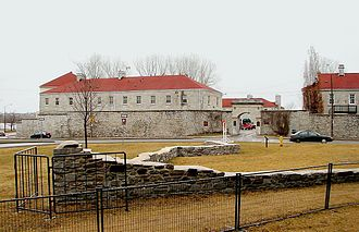 Fort Frontenac - Remnants of the old fort with the new Fort Frontenac in background
