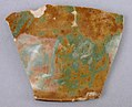 Fragment of a Luster-Painted and Green—Brown Mottled Bowl MET sf32-150-123b.jpg