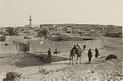 Walled town of El Arish, with camel and men in foreground