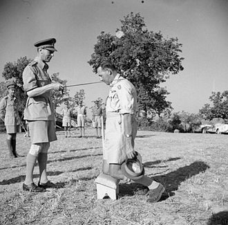 Accolade - King George VI knights General Oliver Leese in the field, 1944.