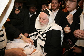 Yaakov Aryeh Alter - Rabbi Alter as Sandek at a bris milah