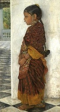 Girl standing in a veranda wearing a Pochampalli sari