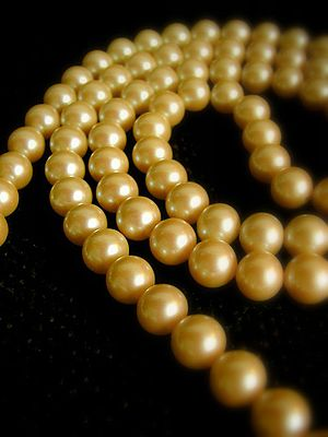 A golden pearl necklace.