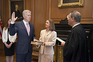 Neil Gorsuch - Gorsuch being administered the first oath of office in a private ceremony by Chief Justice John Roberts