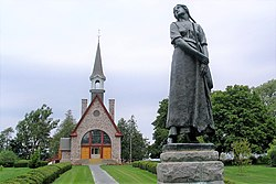 Statue of Longfellow's Evangeline (by Louis-Philippe Hébert) and memorial church