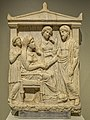 Grave stele of Damasistrate, daughter of Polykleides who shakes hands with her husband who holds a strigil Piraeus 350-325 BCE Greece Pentelic Marble NAM Athens.jpg