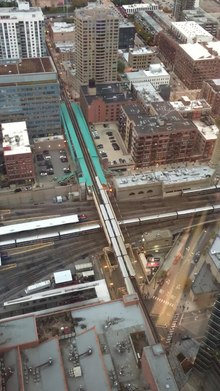 File:Green Line trains pass each other above the Ogilvie terminal.webm