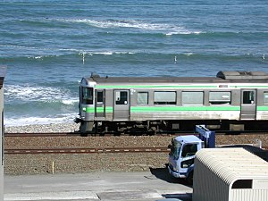 Hakodate Main Line - A local train running along the coast, near Asari Station in Otaru