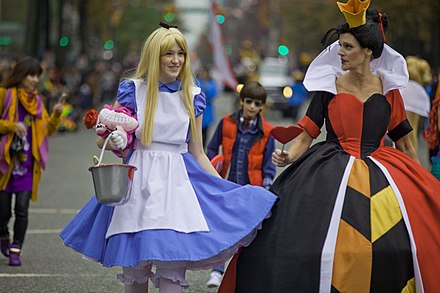 An enormously popular figure in pop culture, a Halloween costume of Alice (and the Queen of Hearts) during a parade in Vancouver, Canada Halloween Parade 2015 (22095223298).jpg