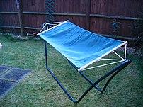 A self supporting w:Hammock in a backyard.