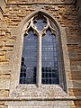 Harlaxton Ss Mary and Peter - exterior tower west window.jpg
