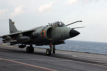 Jet aircraft on deck of aircraft carrier. Its refuelling receptacle is extended near the pilot's canopy