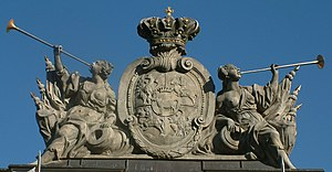Polish–Lithuanian Commonwealth coat of arms. Ciołek i.e. Stanislaus II August coat of arms is placed in the middle of the shield. The sculpture is situated on guardhouse in Poznań.