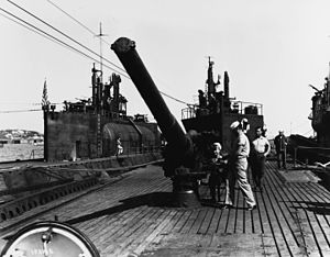 14 cm/40 11th Year Type naval gun - 14 cm/40 11th Year Type naval gun aboard Japanese submarine I-400 being inspected by United States Navy personnel.