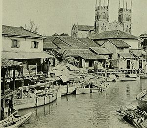 Malacca - Malacca River 1907, Church of St. Francis Xavier in the background